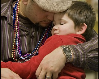 2.24.2009 Miguel Cuevas and his son Jayden, 3, both residents of Lowelville, pray during a Mardi Gras celebration at Faith Community Church on Midlothian Ave in Youngstown, Ohio Feb. 24, 2009. Geoffrey Hauschild