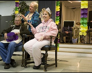 2.24.2009 Event Chairman, Ethel Cantwell, crowns Lew Rotz, of Lowellville, and Jayne Galioto, of struthers, king and queen, during a Mardi Gras celebration at Faith Community Church on Midlothian Ave in Youngstown, Ohio Feb. 24, 2009. Geoffrey Hauschild