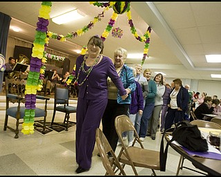 2.24.2009 Sharyle Marcy leads a dance line during a Mardi Gras celebration at Faith Community Church, where Marcy's husband is acting pastor, on Midlothian Ave in Youngstown, Ohio Feb. 24, 2009. Geoffrey Hauschild