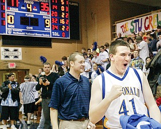 David John of McDonald reacts at end of Tuesday game where Blue Devils beat Springfierld for a20-0 record. Coach Jeff Rasile is at left.
