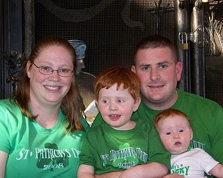 REASON TO CELEBRATE: This picture of the Courson family (Katie, Alex, Allison and Jeremy) was taken last St  Patrick's Day. Jeremy was deployed that day to Afghanistan. He is due back by this St. Patrick's Day.