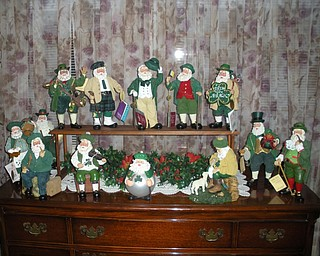 MERRY ST. PATRICK'S DAY? Florence Lloyd, who is 96, is getting ready to celebrate another St. Patrick's Day with her display of Irish Santas, given to her as gifts from her children and grandchildren. This photo was taken by a grandniece, Cindy Reilley Dominic.