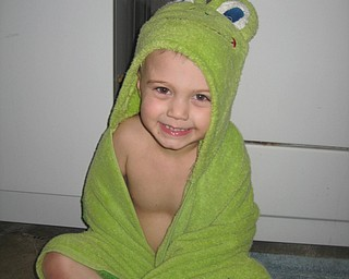 BATHTIME FUN: This is Keaton Mayhew drying off with his froggy green towel. Photo was submitted by Charisse Mayhew, his mom.