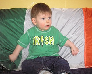 ON THE MOVE: His mom says Liam Johnson, 16 months, of Struthers, doesn't have time to sit still for pictures in front of the Irish flag. He is the son of Maureen Johnson and Ron Moran.