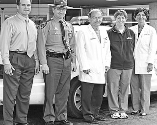 """<p>Special to The Vindicator</p> <p>SAFETY MISSION: Participating in the """"Leave No Senior Behind"""" program are, from left, Edward Hofsess, CEO of New Life Hearing Aid Center; Lt. Chris Heverly of the Ohio State Highway Patrol; and Dr. Robert Gerberry, Mary Sierra, and Dr. Sergul Erzurum, all of Eye Care Associates. The program was initiated to raise awareness of the importance of vision and hearing testing for senior citizen drivers.</p>"""