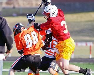 Mooney Pat McGlone 31 high sticks Orange Tom Newnas 88 during scrimmage, Friday March 20, 2009