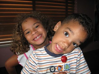 The Walkowiec siblings, DELIA, 8, and ZENIN, 4, of Boardman, share their gap-tooth grins for the camera.
