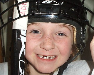 ADELINE SCHWEERS of Poland looks like a true hockey player with her front teeth missing! She is pictured on her way to hockey practice at the Ice Zone. The photo was submitted by her mom, Aimee.