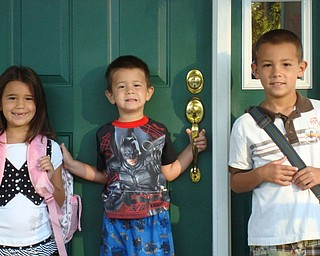 LUCIA ROHRBAUGH, left, is shown on her first day of first grade at C.H. Campbell School in Canfield — minus her two front teeth. Pictured with her are her brothers, Luigi and Lorenzo. The picture taken by their grandmother, Paula D'Apolito.