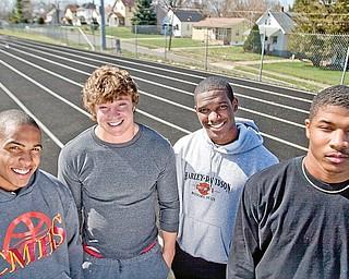 Sprinters on the Cardinal Mooney Track Team, Charlie Brown (sophmore), Scott Johnson (senior), Matt McWilson (senior), Braylon Heard (junior) pose for a portrait at Cardinal Mooney Track on Wednesday April 8, 2009.