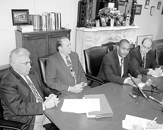 From left, Atty. Danny Thomas of Warren, Law Director Greg Hicks, Safety Service Director Doug Franklin and Mayor Michael O'Brien discuss the agreement with the city John Mandopoulos signed with the city on Wednesday. Mandopoulos, chief since December 2000, agreed to step down immediately and remain on sick leave until Aug. 10, when his retirement begins. Mandopoulos is 61 years old.