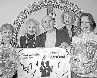 <p>Special to The Vindicator</p> <p>PUTTIN' ON THE RITZ: Items to be awarded during a Chinese auction at the third annual senior prom night at Girard Multi-Generational Center are displayed by, from left, Paulette Kern, administrative assistant at the center; Doloris Krok and Eddie Krok, guests at the center; Laura Carey-D'Rummo, administrative director; and Jennifer Miller, assistant program director.</p>