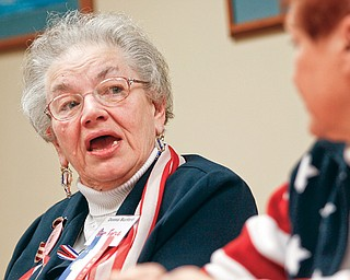Donna Burford discusses her military career and the convention in a board room at Oak Hill Renaissance building along with two other women veterans.
