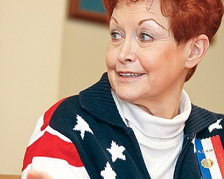 J. Lori Stone of Austintown discusses her military career and the convention in a board room at Oak Hill Renaissance building along with two other women veterans.