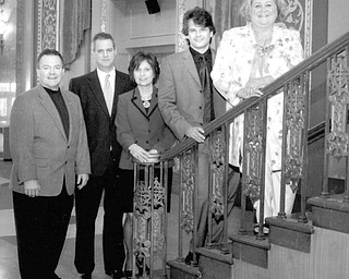 Special to The Vindicator STEPPING UP: Among those participating in arrangements for the Symphony Ball on April 25 are, from left, Tim Smith of Smith and Co. Jewelers; Richard Keyse, ball committee chairman; Patti Smith, ball committee member; Randall Craig Fleischer, music director of Youngstown Symphony Orchestra; and Susan Berny, president of Youngstown Symphony Guild.