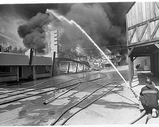 Apr. 26, 1984 Dark clouds fill the sky as Idora Park burns.