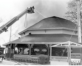 Areial Truck pours water on the roof of the carousel. Apr. 26, 1984