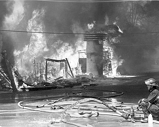 No water:  The fire hoses have little water left to fight the blaze. Apr. 26, 1984