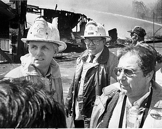 Apr. 26, 1984 Fire chief discusses strategy with assistant chiefs