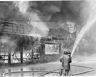 Video arcade, Ski ball and concessions stands burn on the south west side of of the midway. Apr. 26, 1984.