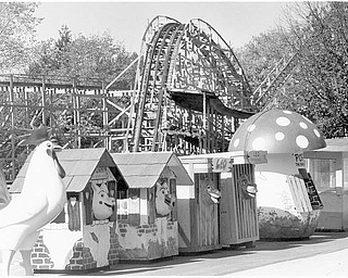 Anyone whoever went to the park will remember the famous trash cans, now lined up for the auction. The remains of the Wild Cat can be seen in the background. Oct. 18, 1984