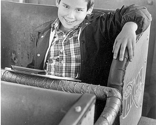 Idora Auction: Last time to sit in the Wilcat cars. The boy is from Chagrin Falls, Oh. Oct. 20, 1984