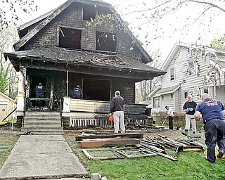 City of Warren Fire investigators and investigators for the state fire marshal remove items as they investigate a early morning blaze that injured a Warren Policeman and three residents. State Fire Marshal investigators have ruled arson as the cause of this morning's fire at a group home on Bonnie Brae Avenue.