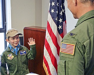 Youngstown Warren Air Force Reserve Station base Commander Col Karl McGregor swears in Tyler Jordan, 8, of Niles as an officer for Pilot for a Day program.