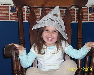 Do you remember the paper hats made from The Vindicator? Here is 3-year-old GIANNA PICCUTA of North Lima wearing one made by her 85-year-old great-grandma, Millie Boda.