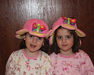 LILY AND CARLINA VARI-COPPOLA, age 4, of Lowellville are wearing their butterfly hats they got at the Buffalo Zoo.
