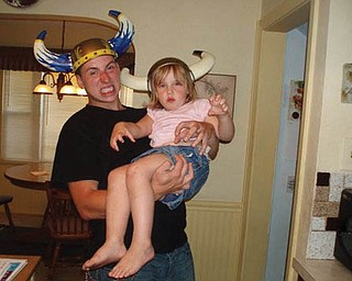 ERICK HOOVER and his niece, Madalyn Smith, are clowning around as vikings.