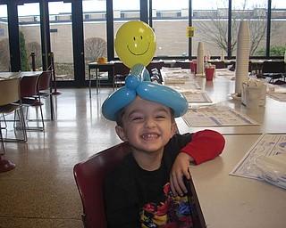 JJ HAGERTY, 3, is wearing a balloon hat at the Boardman Rotary pancake breakfast.