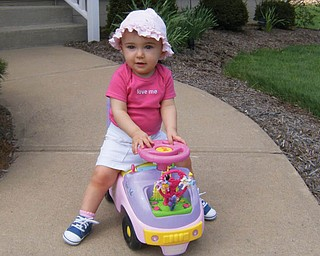 KATIE LYNN DANCE, 1, is ready to go for a springtime ride in her little car. She is the daughter of Bob and Terri Dance of Green Township.