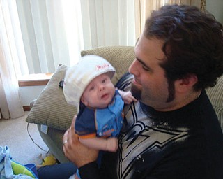 RAIDEN ROSSI, who was born Jan. 20, is held by his father, Ronald, as his mom, Kristie took this picture. The family lives in Austintown.
