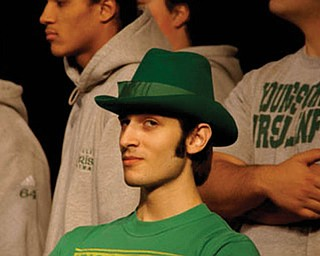 JOEY PASCARELLA of Youngstown, a senior at Ursuline High School, was full of school spirit as he wore the mascot's leprechaun hat for a send-off rally for the football team's state championship game last November, which the Fighting Irish won.