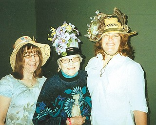BETTY LOU ALLEN with her daughters, Christine Mumforde or Lorain and Linda Armstrong of Boardman, went to a Parade of Hats forYoungstown Women's Connection on April 14. Linda decorated the hats.
