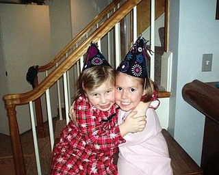 EMILY ZIMMERMAN and Madalyn Smith share a friendship hug on New Year's Eve.