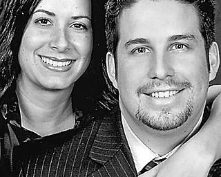 Lisa M. Cambert and Dr. Lucas W. Henn