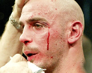 Middleweight World Champion Kelly Pavlik is tended to by a trainer after being beaten by Bernard Hopkins in a non title bout in Atlantic City NJ 10/18/08. William D. Lewis/The Vindicator