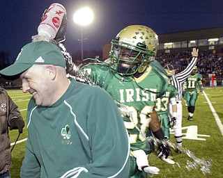 Ursuline High School Coach Dan Reardon gets doused by player Allen Jones during final moments of State championship win 112/29/08 in Massilon. William D. Lewis / The Vindicator