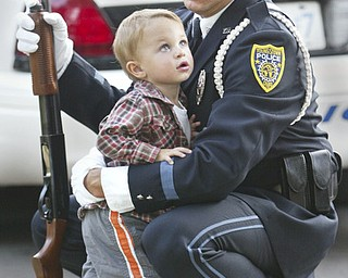 Youngstown Police Dept.Honor Guard member Anthony Marzullo shares a moment with his son Anthony Michael Marzullo, 22 months, during 9/11 ceremony on the green in Canfield Sept. 11, 2008.