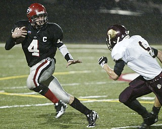 Giard High School quarterback Kyle Stadelmyer scrambles during an October 23, 2008 game with Liberty . William D. Lewis/ The Vindicator