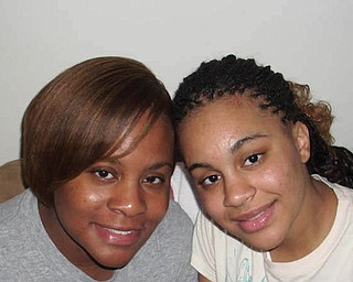Crychelle Portis-Hurlbert, 32, and Crystal Portis, 17, of Youngstown.