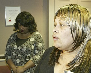 Deborah Chattman, left, aunt of murder victim Helen Moore, and Arvella Smith, a cousin of the murder victim, both of Warren, talk with reporters outside Mahoning County Courtroom after Curtis Young was found guilty on all counts Friday May 8, 2009.