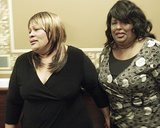 Arvella Smith, left, a cousin of murder victim Helen Moore and Deborah Chattman, aunt of murder victim, both of Warren, react outside Mahoning County Courtroom after Curtis Young was found guilty on all counts Friday May 8, 2009.