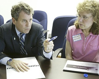 US Sen Sherrod Brown talks with Mary Hudzik of Warren, a member of Delphi Salaried Retirees Association, during a meeting concerning Delphi retirees benefits Monday at the UAW 1112 hall in Lordstown.