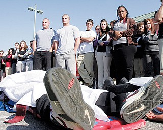 PLAYING DEAD: New Castle High School senior Ta'Shan Jones was one of several students from the school to portray an accident victim during a mock crash Tuesday. The event was designed to demonstrate the dangers of drinking and driving.