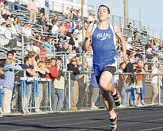 Poland's Robert Balzano places first for the Boys 400 Meter Dash at Poland High School, Tuesday May 12, 2009