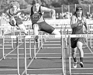 Canfield Tyler Mettille (red) places first in the Boys 110 Meter Hurdles with Howland Dante Marsh, on right, trailing right behind him at Poland High School, Tuesday May 12, 2009.