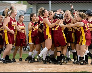 5.14.2009 Cardinal Mooney's Meg Williams (27) is congratulated by her teamates after hitting a homerun during the bottom of the second inning at Boardman's Field of Dreams on Thursday evening. Geoffrey Hauschild